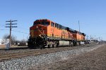 Just out of the yard, D802 heads west past milepost 5 with light power for West Olive
