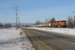 BNSF 5796 leads N956-01 east along Chicago Dr