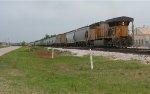 UP 6927 pushing the grain train toward Bryan