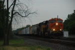 BNSF 7050 takes charge of an eastbound mixer.