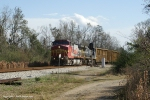 BNSF 644 lifts Q52013 out of the siding at Molino,