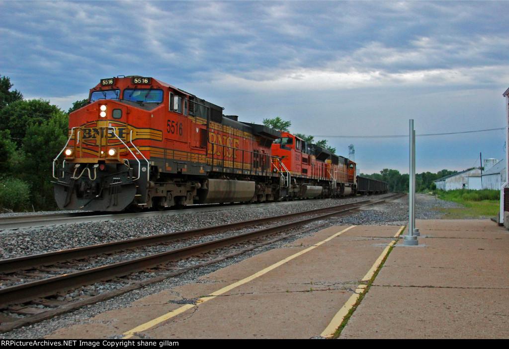 BNSF 5516 Leads a EB Frac Sand train.