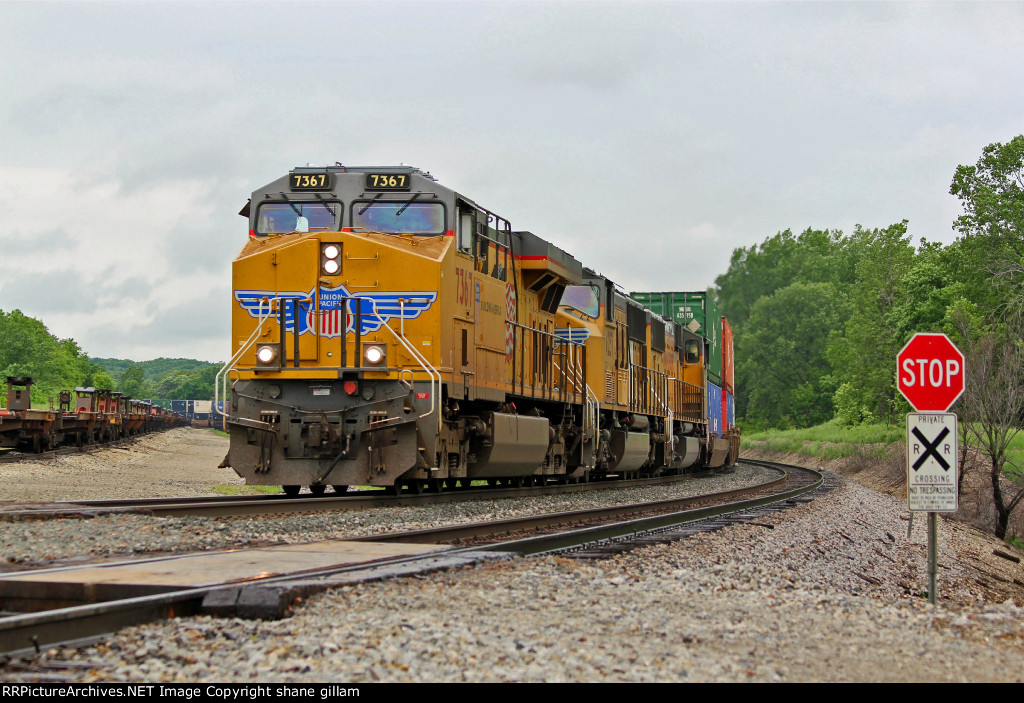 UP 7367 Swings a EB stack Thur town.