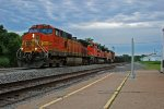 BNSF 5516 Leads a EB Frac Sand train.