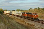 BNSF 7813 Leads a WB stack in golden light.