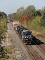 With a bit of fall color in the trees, 14W rolls east on the Chicago Line across northern Indiana