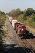 A pair of grungy GE's bring CP train 242 east