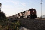 BNSF 5817 & 8873 come east out of the evening sun with the coal loads of 614