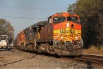 A pair of BNSF Dash-9's and a CSX ES44AC roll through Fostoria with K040