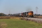 Loaded oil train K010 picks up speed as its pulls east