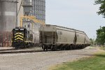 Already loaded grain cars sit south of the main while another cut is loaded