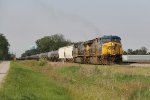 CSX 624 rolls through the weedy west siding as it leads K421-16 south