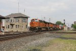 CG Tower stands by as BNSF 6606 leads Q171 past