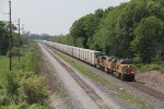 Making good speed, Q090 rolls east on Track 1