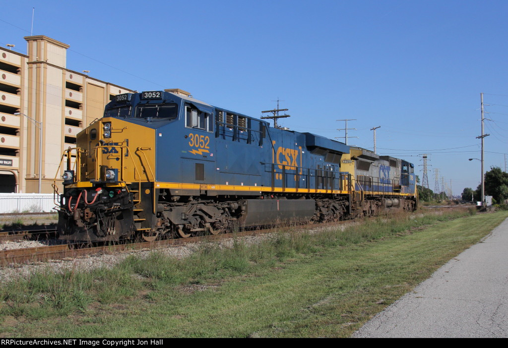 CSX 3052 & 7765 wait on the Lakefront Sub for a coke train to take east