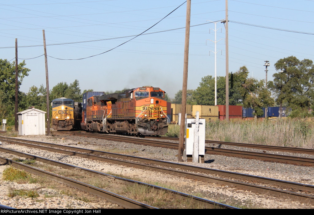 CSX 5487 starts onto the diamonds eastbound with Q368 three car lengths behind S172