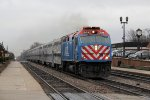 METX 209 races west with an express at 14 after 6 in the evening