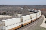 Z-ALTWSP8 rolls away east with a long block of stacked UPS containers on the head end