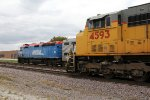 UP 4593 crawls west as Metra 141 races by eastward