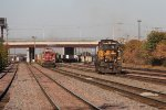 G39 starts east as light power as GY11 shoves back with containers for an outbound