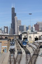 Engines sitting at the Amtrak shop rest below the Chicago skyline