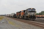 NS 9569 leads BNSF 6519 & 5044 east on the point of 34G