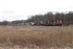 CN 5780 & 5405 slowly pull down toward the junction to wait for maintainers with M399