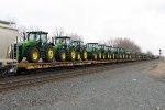 A decent cut of John Deere tractors follow along on 18A past mile 499