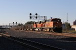 N903, a CSX train with BNSF power on NS rails, rolls east with coal loads for West Olive