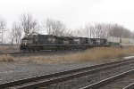 As the weather goes downhill, NS 7656 streaks by leading 21G