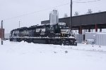 NS 3271 and 7111 rest in the snow at East Wayne yard