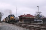 CSX 8239 accelerates with an Eastbound manifest through town