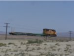 A short Union Pacific MOW train led by UP 4892