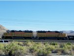 Union Pacific UP 1528 and UP 1450 with single gondola