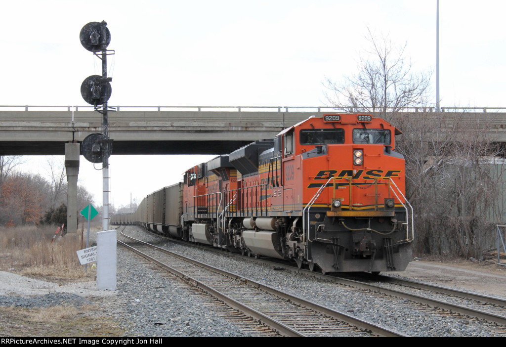Clear of Pleasant St, D803 throttles up to Notch 8 while pushing the 130 coal loads of N956 up the hills east of town