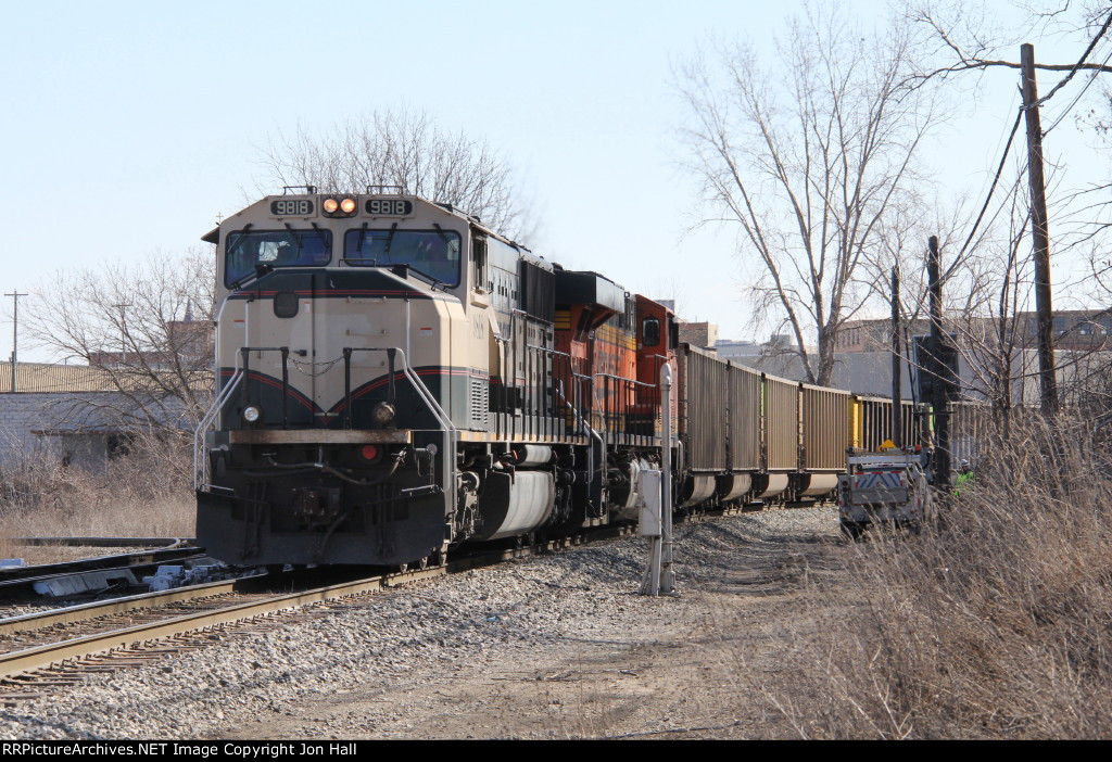 A maintainer waits for track time as D801 rolls past at the rear of N956