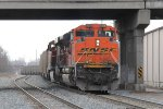 D803 works hard pushing N956 east as it passes under Franklin St