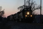 CSX 8060 leads the 7519 & 4845 east at Seymour with Q334-02 as the sunset fades