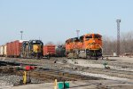Using BNSF power, Y106 crosses over to the Old Even as Y193 prepares to start breaking down the inbound Q326