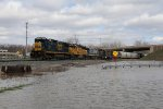 As the last train out of Wyoming for the next several days, Q327 heads west with yard power being moved to escape the rising flood waters