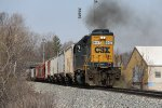 CSX 8447 works hard as it keeps a lengthy D707 moving east