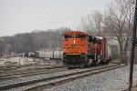 Winding its way through Plaster Creek, Q335 arrives at Wyoming Yard with BNSF power