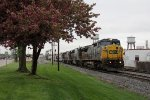Even on a gloomy spring day, the flowering trees are still blooming as 7378 leads Q326 east through Grandville