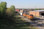 BNSF 5426 & 5000 roll west through town under the morning sun with Q335-16
