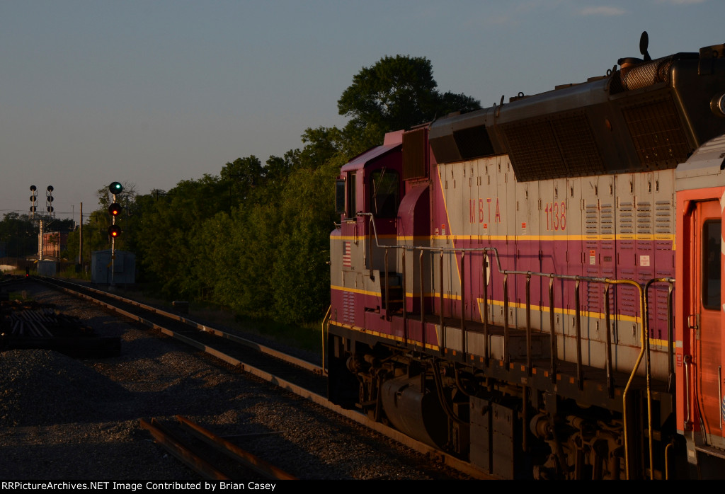An outbound commuter rail train gets a green signal to leave Salem, MA station.