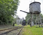 Double Header Approaches Water Tower