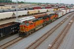 BNSF 4440 rolls in a freight train into the yard with a freight.