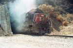 EMD SD-45R blasting out of a tunnel on the summit of the Cuesta Grade
