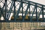 AK Bridge: CSX 5393, 504 approaching mid span.