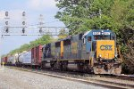 A pair of standard cab SD50's lead westbound tonnage at Columbus Ave